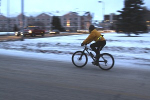 A winter bicyclist rides down 10th Avenue in Anchorage near the Delaney Park Strip during November 2009